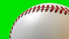 A traditional baseball ball with a leather and stitched surface rotating once Stock Footage