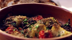 Cod and chorizo bake in earthenware dish, close up rack focus Stock Footage