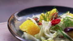 Shaved fennel and orange salad on plate, close up pan Stock Footage