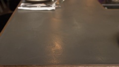Empty place setting at a restaurant bar, camera slider shot Stock Footage