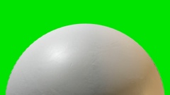 A traditional white cricket ball with a leather stitched surface rotating once Stock Footage