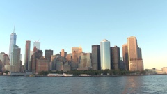 Famous Lower Manhattan financial district skyline as seen from the NYC harbor Stock Footage