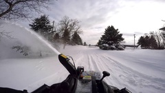 Snowblower pov clearing the driveway 60fps Stock Footage