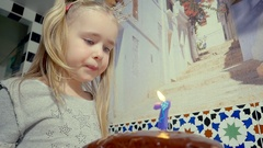 Celebrate the birthday of a beautiful, little girl who blows out the candles on Stock Footage
