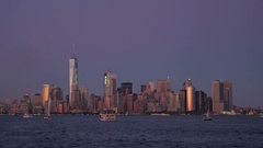 New York City lights and iconic Downtown Manhattan skyline on stunning evening Stock Footage