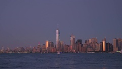 Cruising in Upper Bay overlooking iconic Lower Manhattan skyline at sunset Stock Footage