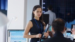 4K Financial manager in stock exchange overseeing staff & giving instructions Stock Footage