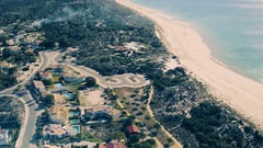 Flying Above Holiday Village on Shore Ocean Stock Footage