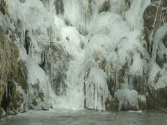 Frozen waterfall with ice formations in slow motion Stock Footage
