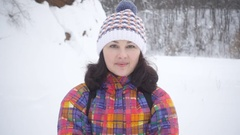 Young woman blows snow with hands on the camera..Beauty Winter Girl Blowing.. Stock Footage