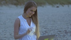 The girl is talking to relatives in video call Stock Footage