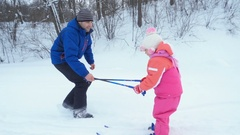 Father teaching his little daughter to ski. Cute little girl learning to ri.. Stock Footage