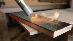 Board burning fire of a gas burner. sostarivayut tree. color wenge Stock Footage