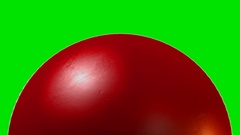 A traditional red cricket ball with a leather stitched surface rotating once Stock Footage