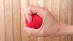 Hand squeeze red stress ball. Concept of anger, pressure and frustration. Stock Footage