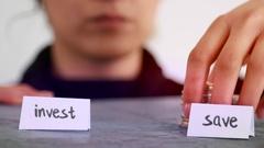 Invest money vs save money concept Stock Footage