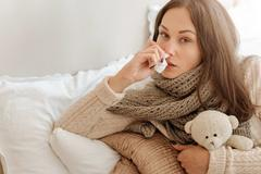 Weak woman snuffling in the bedroom Stock Photos