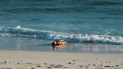 Man in snapback run to rescue drowned girl on ocean sandy beach, pulls her hands Stock Footage