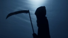 Unstoppable Grim Reaper carrying sharp scythe to punish evil-doers, horror film Stock Footage