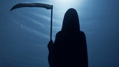 Grim Reaper with scythe turning back, walking away to give victim second chance Stock Footage
