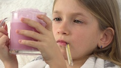 4K Sick Child with Drinking Drugs, Sad Ill Girl Face with Thermometer on Sofa  Stock Footage
