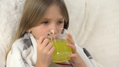 4K Sick Child Face Drinking Drugs, Sad Ill Girl Portrait takes Medicaments, Sofa Stock Footage