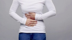 Woman suffering from stomach ache Stock Footage