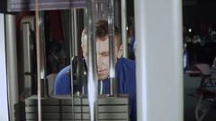 Man at the gym, training triceps hands. The man lifts heavy weight in the gym Stock Footage