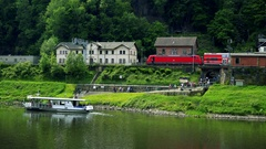 People leave a ferry boat at a train station in a rural area Stock Footage