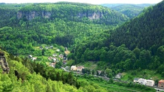 A village enclosed with a forest and rocks - top view Stock Footage