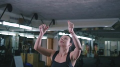 Young woman warming up and doing some sports exercises a the gym, slow motion Stock Footage