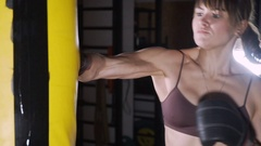 Female Boxer training in Boxing Club. The sports beautiful woman beats a Arkistovideo