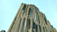 A columnar basalt rock and the bright blue sky Stock Footage