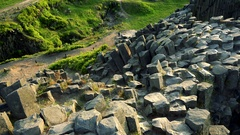 The top of a columnar basalt rock near a lake .- top view Stock Footage