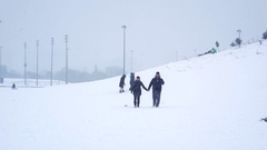 Kids enjoying a small ski hill on a snowy day in Etobicoke, Canada.  Man and Stock Footage
