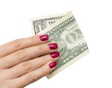 One dollar in the hand of the girl on a white background Stock Photos