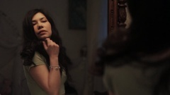 Playful woman in green top flirting with reflection in mirror, play with bunny Stock Footage