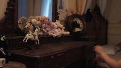 Little girl runs to wooden table with toys and mirror in bedroom Stock Footage