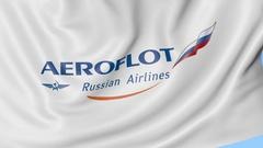 Waving flag of Aeroflot against blue sky background, seamless loop. Editorial 4K Stock Footage