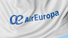 Waving flag of Air Europa against blue sky background, seamless loop. Editorial Stock Footage