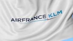 Waving flag of Air France KLM against blue sky background, seamless loop Stock Footage