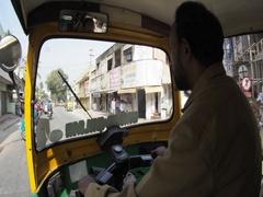 View from inside auto-rickshaw of urban traffic in Bangalore, Karnataka, India Stock Footage