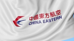 Waving flag of China Eastern Airlines against blue sky background, seamless loop Stock Footage