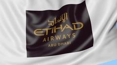 Waving flag of Etihad Airways against blue sky background, seamless loop Stock Footage