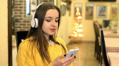 Girl listening melancholic music and thinking about something, steadycam shot Stock Footage