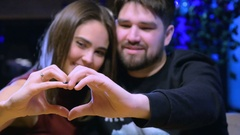 Love, romantic young couple forming heart shape with their hands. Valentine's Stock Footage