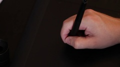 The designer uses the pen. Graphic tablet closeup Stock Footage