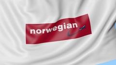 Waving flag of Norwegian Air Shuttle against blue sky background, seamless loop Stock Footage