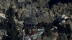 Palm Springs, USA 1985: Aerial Tramway cabin arrives at the station Stock Footage