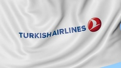 Waving flag of Turkish Airlines against blue sky background, seamless loop Stock Footage